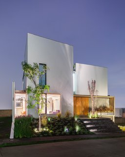 An Open, Light-Filled House in Mexico City - Photo 5 of 8 - The facade at dusk. Photo courtesy of JSa.