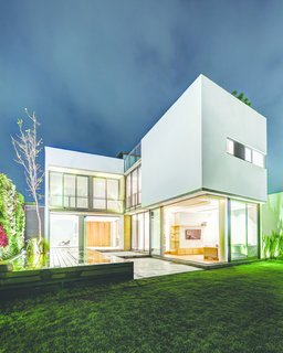 An Open, Light-Filled House in Mexico City - Photo 8 of 8 - The rear of the house as seen at dusk. Photo courtesy of JSa.