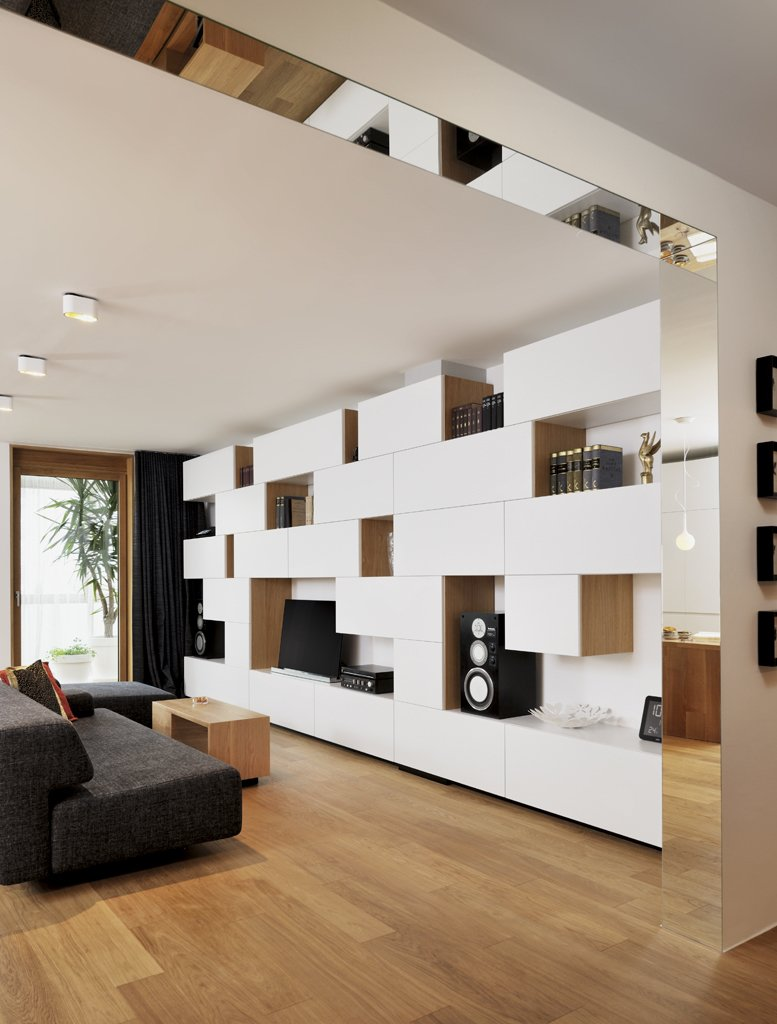 """In recasting a 1,000-square-foot apartment in Ljubljana, Slovenia, Lidija Dragisic of Studio 360 sought to create a modern, adaptable residence. """"Small spaces are a big challenge and inspiration,"""" she says. """"The goal is to make small areas look and feel big, and to be as useful as much bigger spaces are."""" Dragisic introduced a raft of built-ins, minimalist furniture, and a detailed lighting plan in this overhaul.  Storage by Dwell from A Compact Minimalist Apartment in Slovenia"""