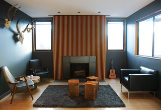 "You Won't Be Calling This House a ""Man Cave"" - Photo 2 of 9 - A series of Douglas fir slats was applied above the fireplace."