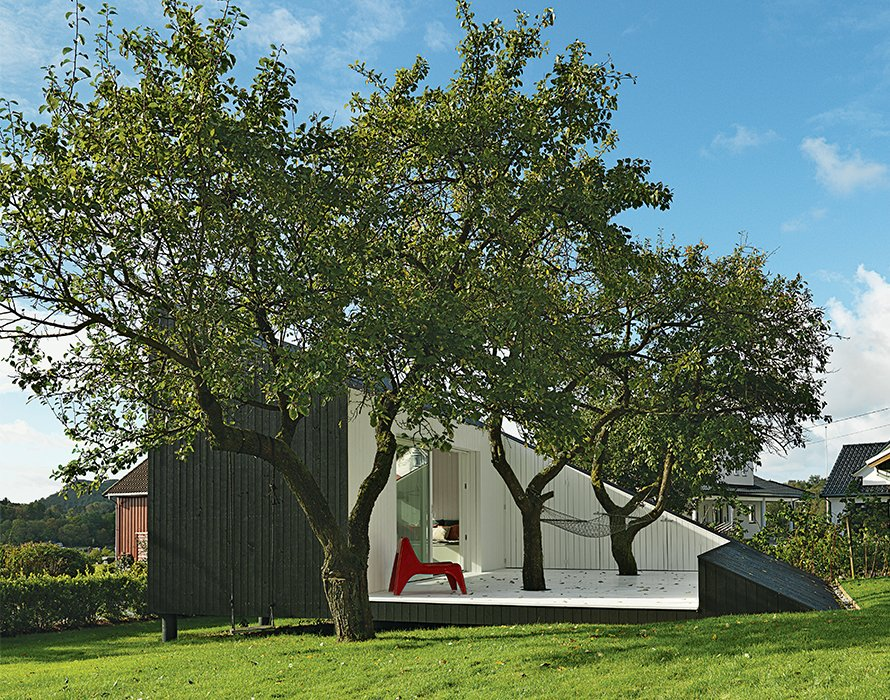 Outside, Saunders carefully preserved a pair of mature plum trees by building the patio around them.