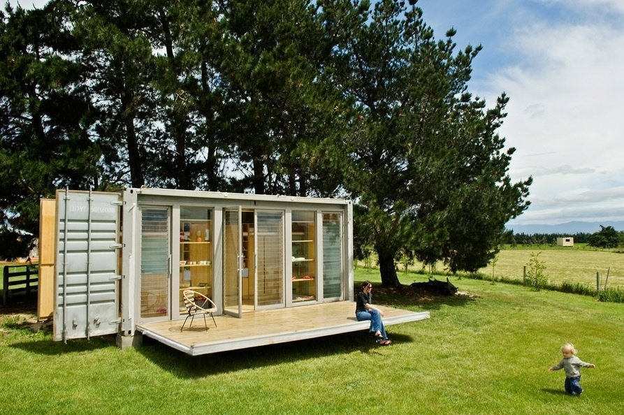 A small shipping container home in New Plymouth, New Zealand features a retractable porch. Photo credit: Paul McCredie  Amazing Examples of Shipping Container Architecture by Diana Budds from How to Buy a Shipping Container