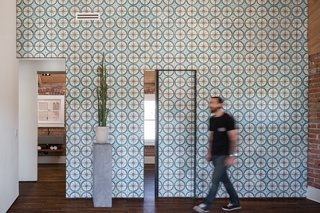 12 Creative Ways to Use Tile in Your Home - Photo 6 of 12 - Off the living room, two small bedrooms and a bathroom can be reached through sliding doors that, when closed, continue the cheerful pattern of the Moroccan cement tiles covering the wall.