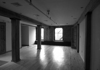 This Cozy Home Totally Changes How We Think of Tribeca Lofts - Photo 2 of 9 - A before shot of the living/dining room.