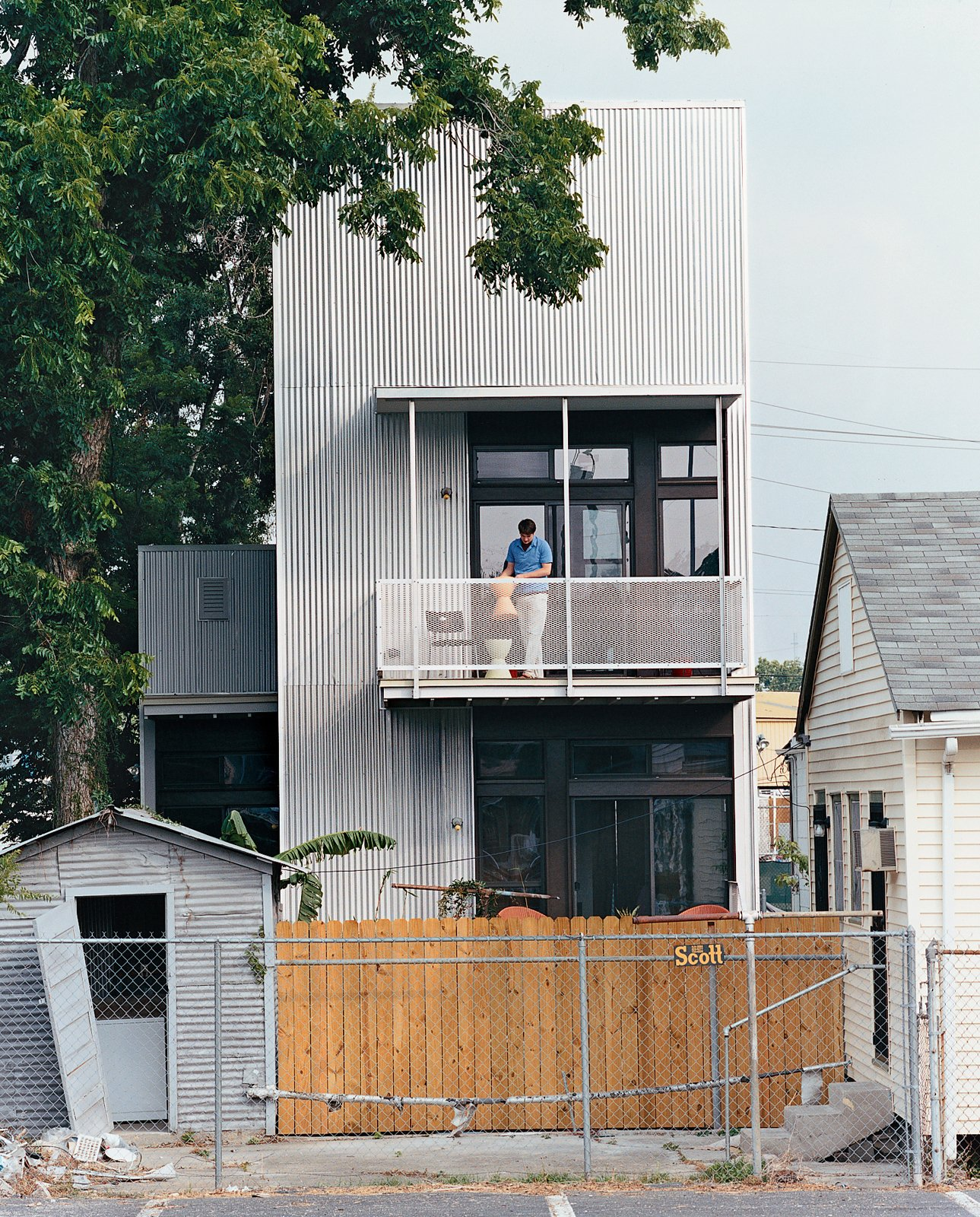 Resident Tony Vanky gets the second-story deck prepared for guests. The grittiness of the Black Pearl neighborhood is plainly visible.  Photo 10 of 11 in New Orleans, LA