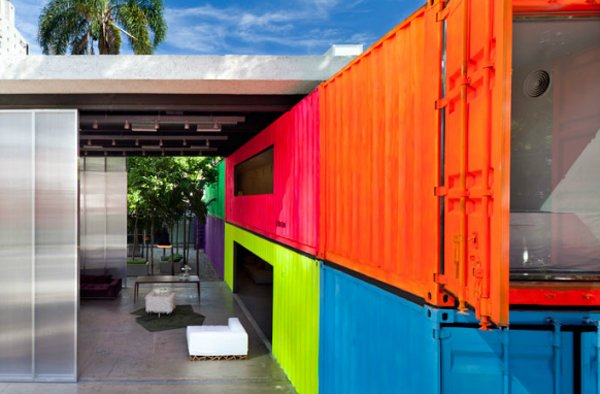 Decameron (Sao Paulo, Brazil)  Brazilian architect Marcio Kogan turned an empty urban alley into a neon-drenched retreat, complete with a small garden, by repurposing shipping containers.   Photo by Pedro Vannucchi  Shipping Containers by Dwell from Examples of Shipping Container Architecture