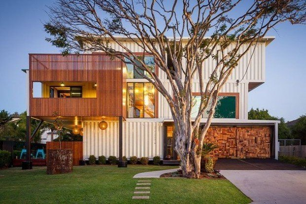 Shipping Container Home (Brisbane, Australia)  Architect and designer Todd Miller didn't just use a shipping container for this home—it appears like he used an entire shipping company, since it took 31 containers to build this industrial but inviting home, which features a massive graffiti mural on the back wall.   Photo by ZieglerBuild  Shipping Containers by Dwell from Examples of Shipping Container Architecture