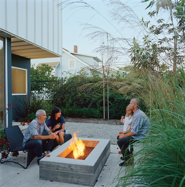 California isn't known for its front porch culture, but Grunbaum loves Venice's walk streets and their pedestrian vibe, so he employed landscape designer Stephanie Bartron to orient his small patio towards the street. The house itself acts as a windbreak, and lush patio furniture and a small fire pit turn what could have been another exercise in backyard solipsism into the home's most neighborly spot.