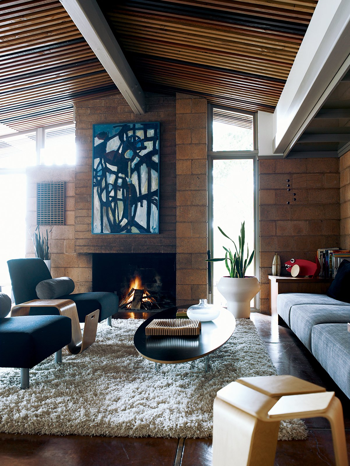 The chairs and end table in the living room are of Eric's design. Tagged: Living Room, Coffee Tables, End Tables, Sofa, Chair, Stools, Standard Layout Fireplace, Wood Burning Fireplace, and Rug Floor.  Photo 3 of 9 in Oakland Aesthetics