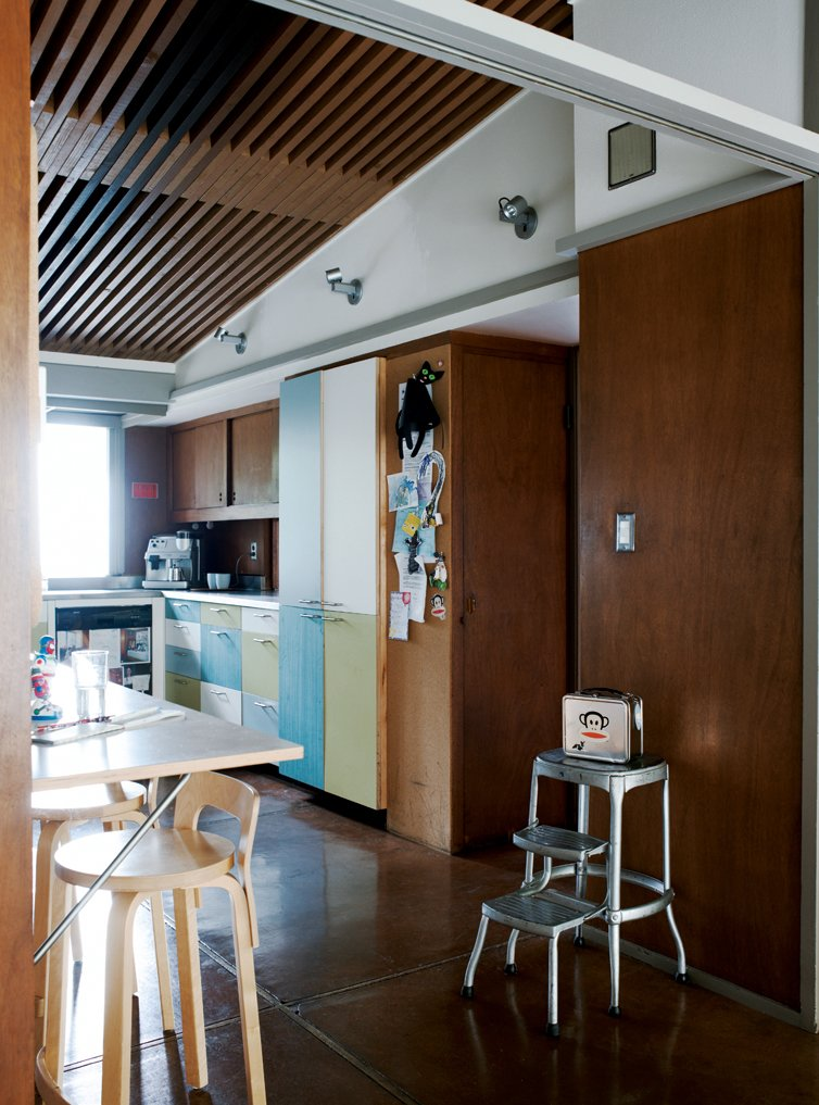 To temper the house's warm tones, the couple opted for cool cabinet facings in   the kitchen.