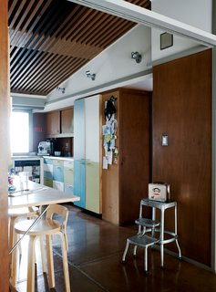 To temper the house's warm tones, the couple opted for cool cabinet facings in <br><br>the kitchen.