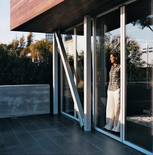 Double the Pleasure - Photo 3 of 11 - Maricarmen looks out toward the ocean from inside the sliding glass NanaWall.