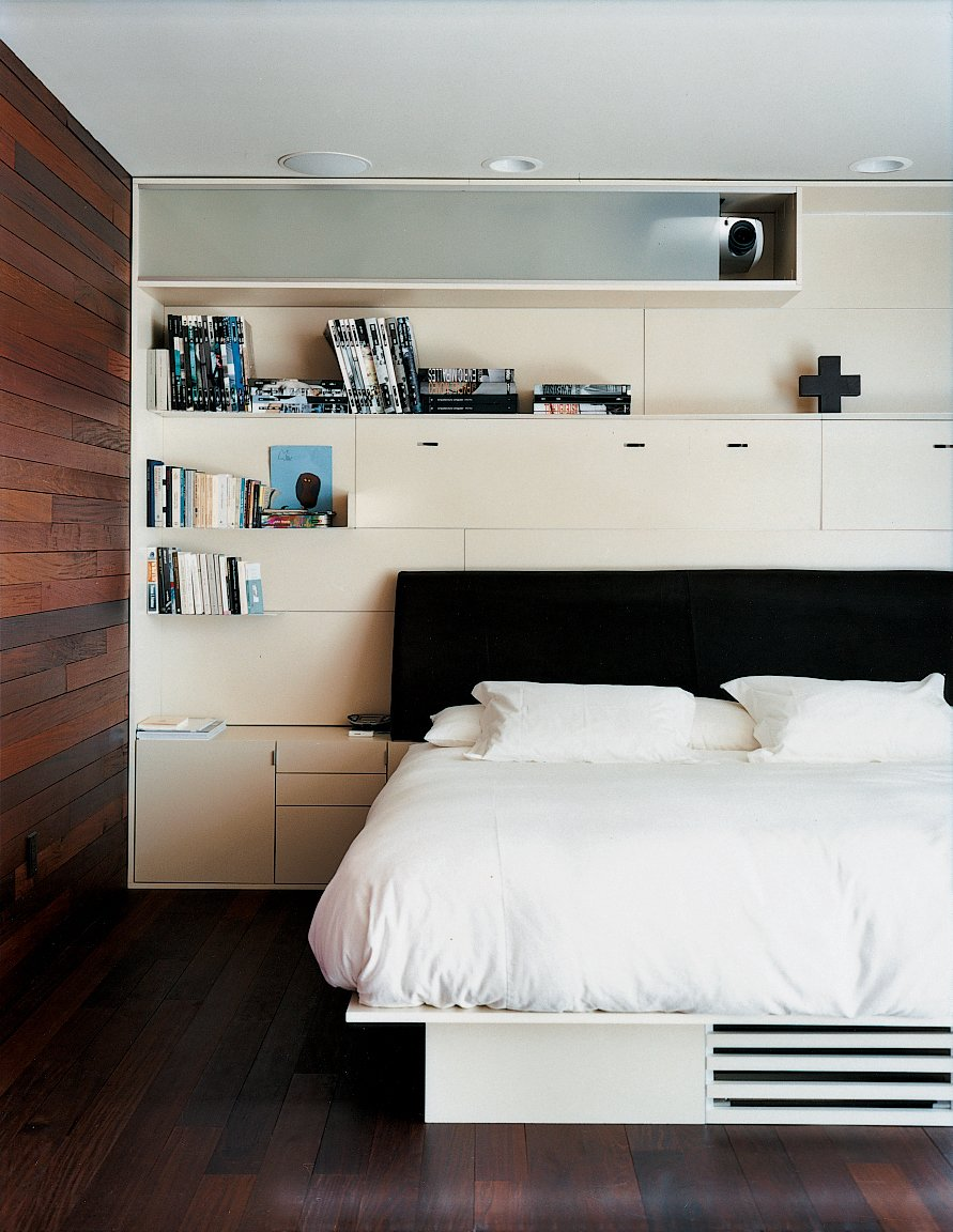 The master bedroom. The diminutive dimensions of the private upstairs level are meant to push the Mariscals toward the common areas. Tagged: Bedroom and Bed.  Bedrooms by Dwell from Double the Pleasure