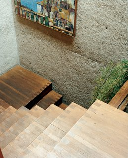 Ray Kappe-Designed Multilevel House in Los Angeles - Photo 2 of 12 - Rail-free stairs are unnerving for a first-time visitor, but they amplify the home's free-flowing sense of space and structure. The stairs were built inside one of the six concrete towers, and they lead from the central living space to the front door. The experience of moving from the enclosed stairway into the expansive open family area is dramatic.
