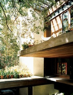 Ray Kappe-Designed Multilevel House in Los Angeles - Photo 3 of 12 - The front door is tucked under a cantilevered terrace.