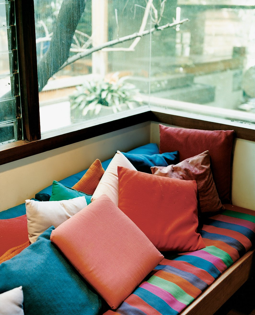 The exposed wood and raw concrete throughout the house are offset by bold colors, chosen by Shelly and the children. The house's warm hues can clearly be seen in this window seat in Ray's office. Ray Kappe-Designed Multilevel House in Los Angeles - Photo 6 of 12