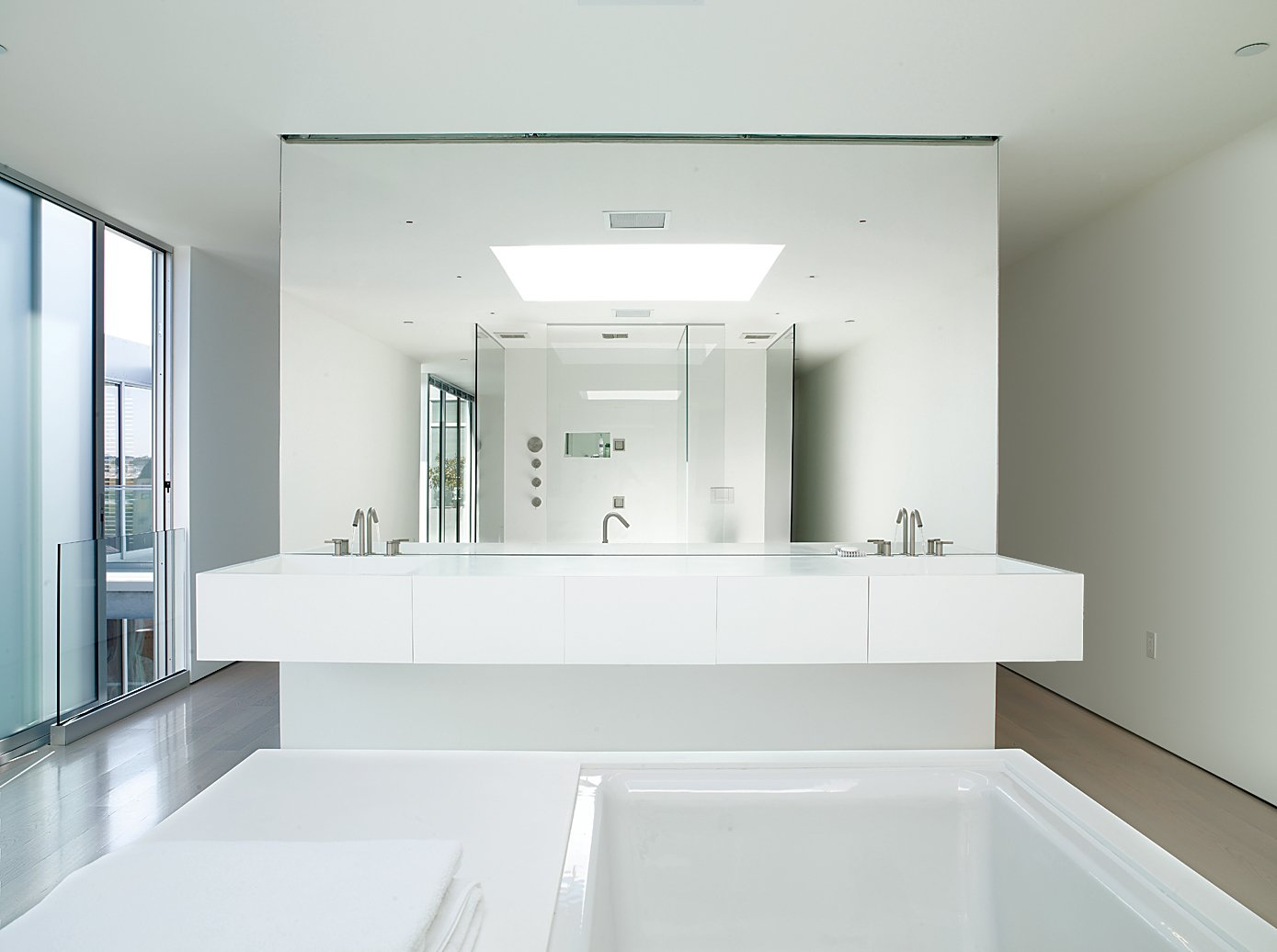 The master bathroom is outfitted with Kohler fixtures and custom pieces.