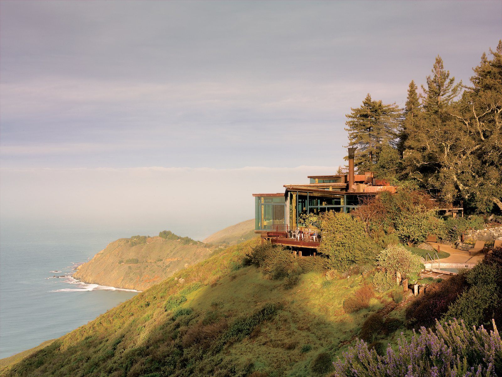 The interiors of many of Mickey Muennig's houses emphasize natural building materials such as wood, concrete, and stone. Tagged: Exterior, House, and Wood Siding Material.  Photo 3 of 9 in Big Sur: Coastal Commissions