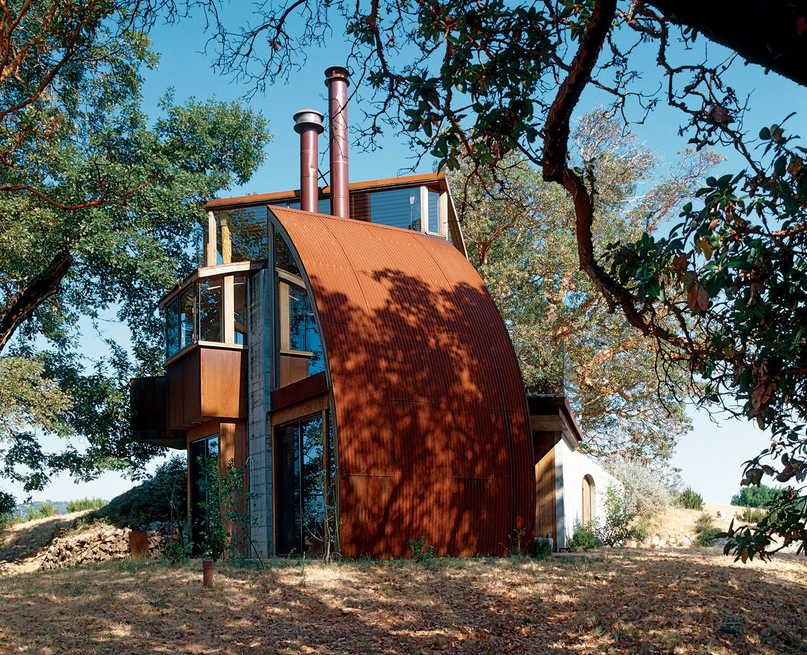 Hidden away up a perilous dirt road, the Witt Guesthouse, in its material and construction, reflects the wildness of the beauty that surrounds it. Tagged: Exterior, Metal Roof Material, Metal Siding Material, and House.  Photo 9 of 9 in Big Sur: Coastal Commissions