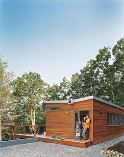 "A ""tree house"" of clean lines, ample glass, and thoughtful ingenuity lets a Washington, DC–area family and a stream of weekend guests enjoy prefab living in an unlikely locale—just outside Lost River, West Virginia."