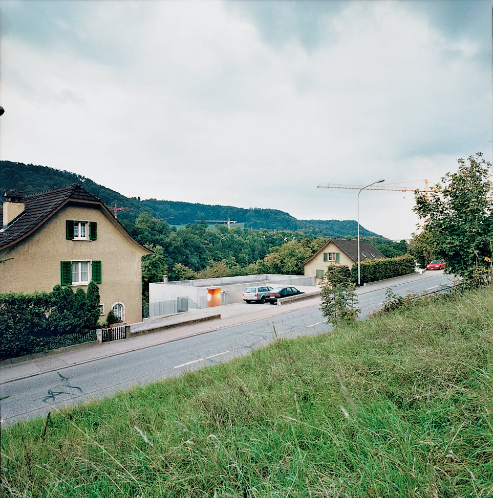 The house is located on the busy Schaffhauserstrasse, which links Switzerland to Germany, and therefore part of Oesch's brief was to reduce noise and orient the building toward the nearby Rhine.  Photo 1 of 11 in Swiss Mix