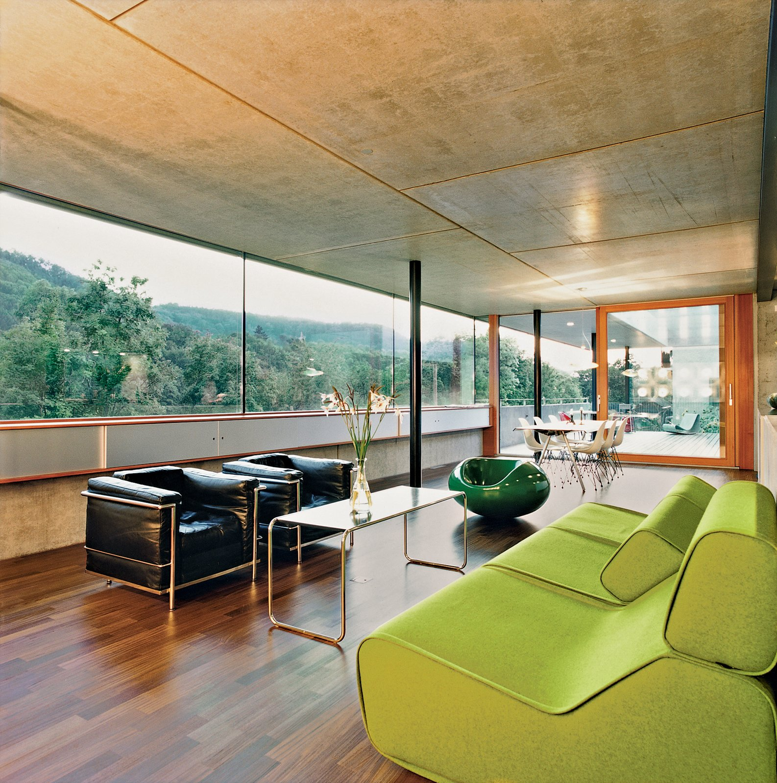 After walking through the front door visitors enter directly into the enormous kitchen and living space. The interior is minimal, using predominantly timber and concrete. It also provides some spectacular views of the river.  Photo 6 of 11 in Swiss Mix