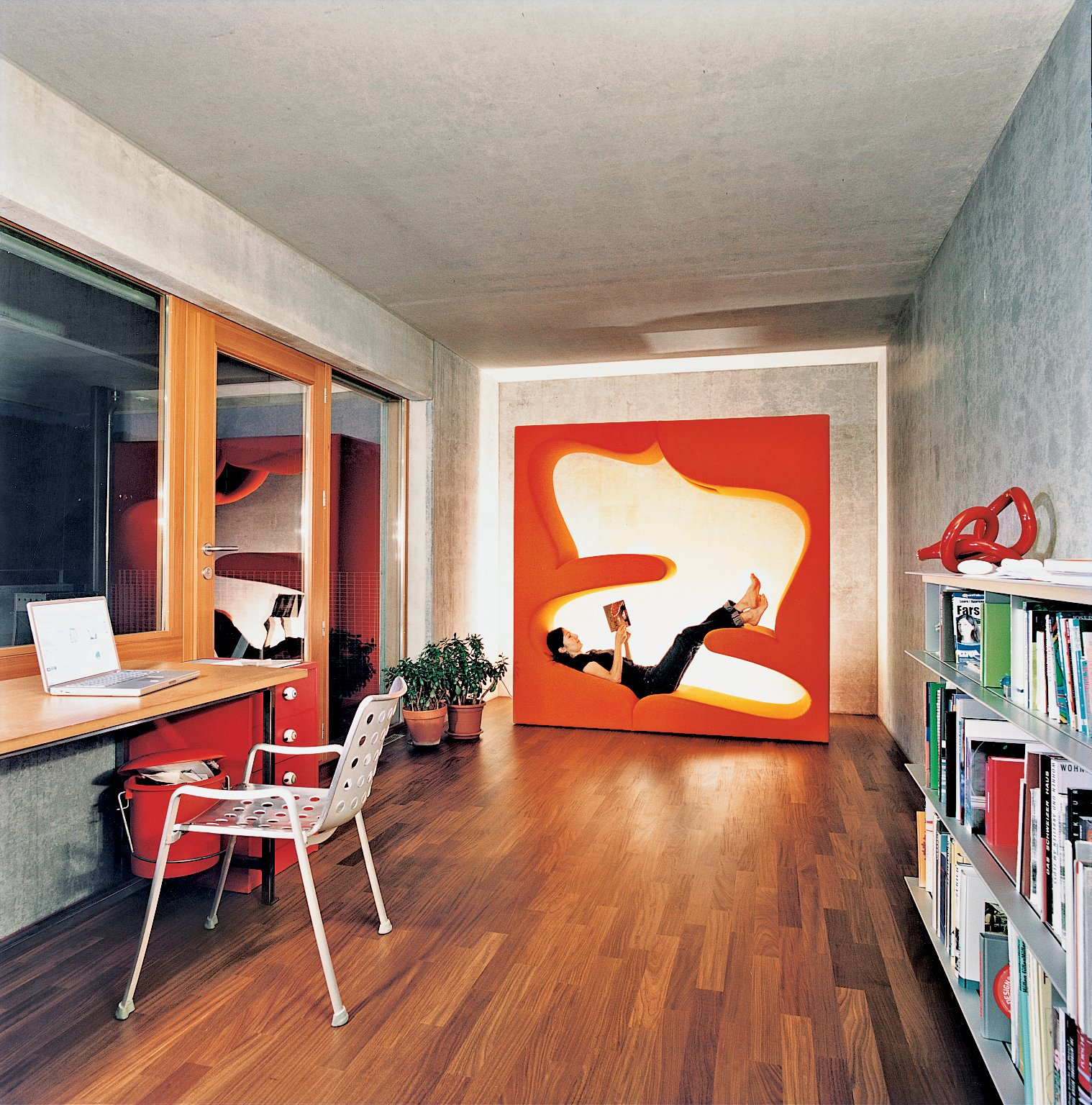 The office includes the Living Tower designed by Verner Panton for Vitra. Tagged: Living Room, Medium Hardwood Floor, and Recliner.  Home Offices and Workspaces We Love by Matthew Keeshin from Swiss Mix