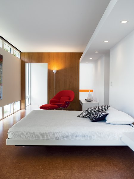 The bedroom is a comfortable show of geometric regularity.