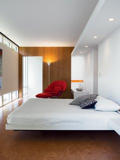 Massie Produced - Photo 11 of 11 - The bedroom is a comfortable show of geometric regularity.