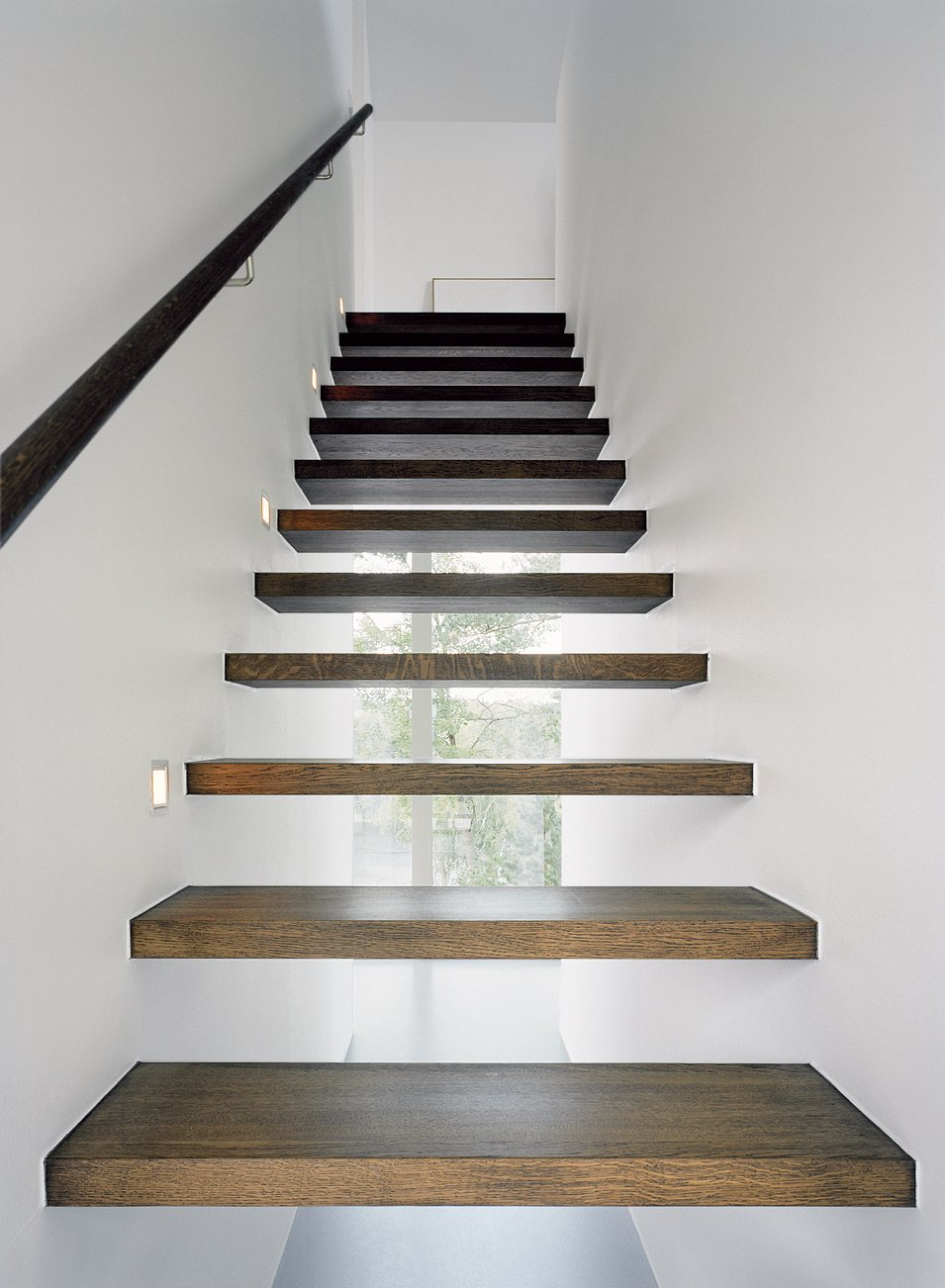 Arkitekthus charges a little extra for the see-through staircase; the basic house has under-staircase storage, which is more practical but less beautiful. Tagged: Staircase and Wood Tread. Sum of Its Parts - Photo 7 of 13