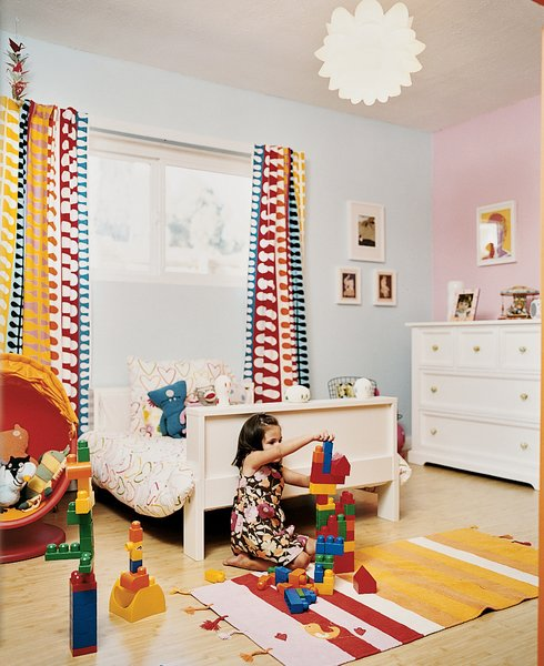 Even in Ella's room, Ikea chairs and bed mingle with a restored Bertoia child's chair.