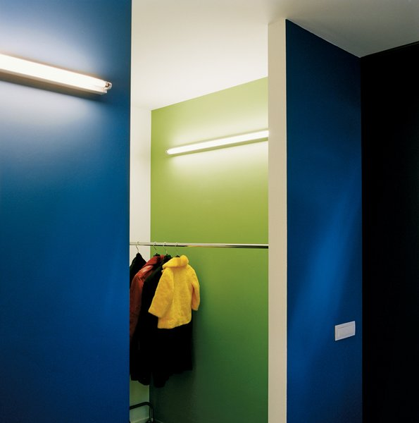 """Simple wall-mounted strip lighting, seen here in the cloakroom, is used throughout the house. """"The beauty is the light, not the fitting,"""" explains Van Everbroeck. Tagged: Storage Room and Closet Storage Type.  Photo 7 of 11 in The Tree of Ghent"""