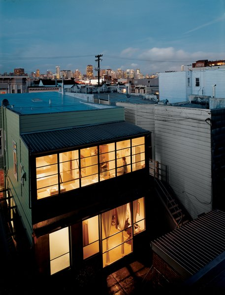 """If there were a theme song for architect Christi Azevedo's rehabilitation of the crumbling 1885 abode she purchased in San Francisco's Mission District, it would have to be """"Love the One You're With."""" Instead of an extreme makeover, the self-described modernist undertook a thoughtful refurbishment—–preserving trim,   retaining the layout, making furniture from framing lumber excavated from the site, and fabricating new elements as needed. Musing on the Victorian hybrid that she shares with her partner, Katherine Catlos, Azevedo notes, """"I think the world will look more and more like Blade Runner, where you have an old Chevy Nova as well as some crazy thing flying through the air. There's room for both."""""""
