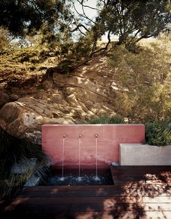 Echo Logical - Photo 2 of 15 - An outdoor water feature adds a subtle soundtrack to the property while keeping the plants irrigated.