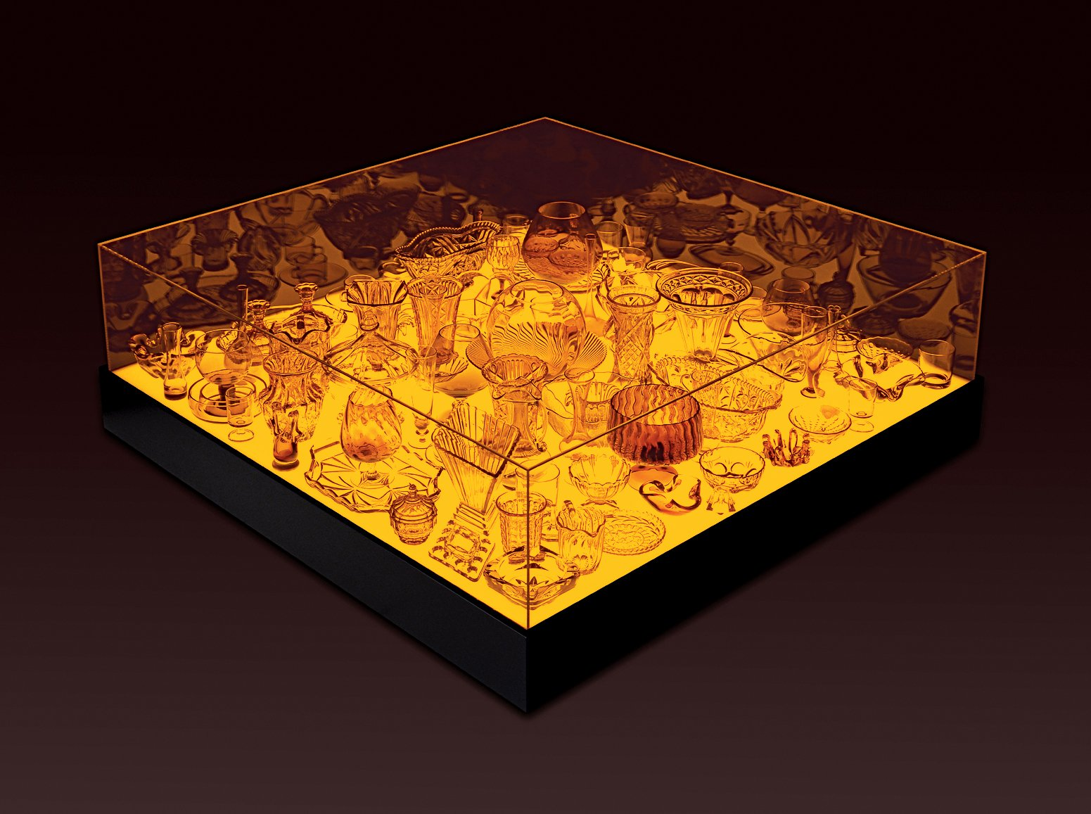 The 2006 Aladdin table, which houses an assemblage of glass pieces within an amber light box. Design Junkie - Photo 5 of 13