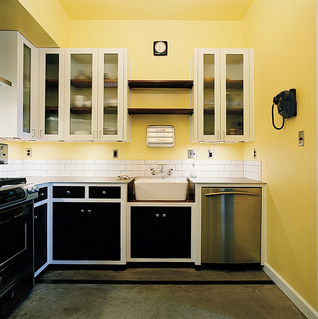 Almost every element of the interior—from the kitchen cabinetry to the art on the walls—was created by Dollahite himself. Tagged: Kitchen and Dishwasher.  Photo 3 of 10 in Salvage Love