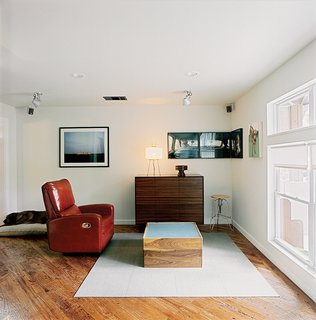 The media cabinet and lightbox coffee table exemplify Dollahite's furniture-making talents. After finishing the house he founded a studio, Rural Theory, to apply his talents elsewhere.