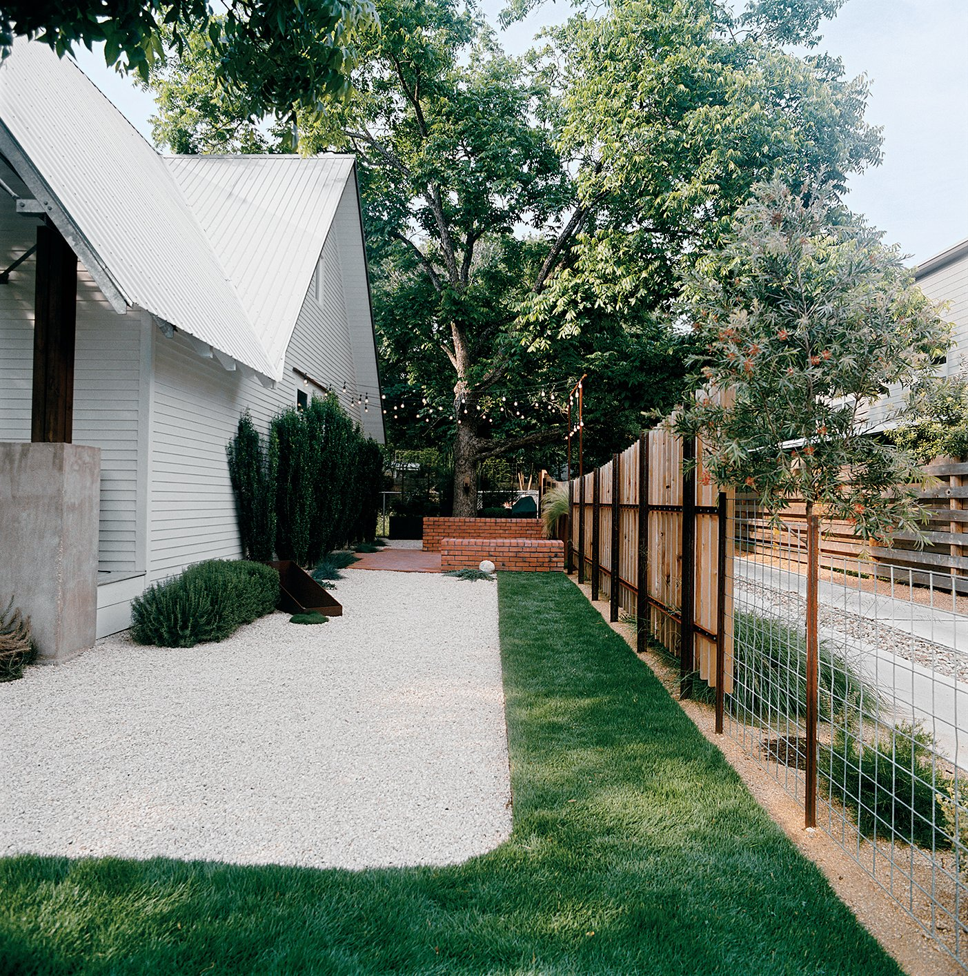 Patches of sod amid white gravel keep water needs low.