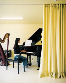 Musical accompaniment to daily life is provided by the children, both of whom play the grand piano.