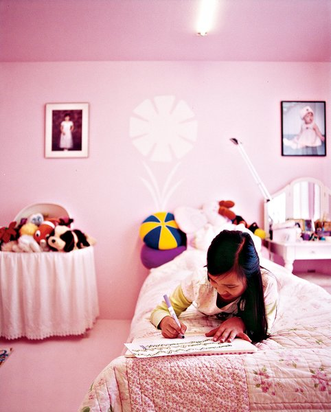"Inside, the space is spare but infused with color because ""painting is the cheapest way to decorate."" Twelve-year-old Tabitha's room is pink."