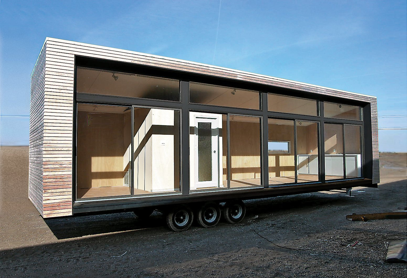 "Architect Christopher C. Deam's Glassic Flat attempts to put the ""pre"" back into prefab: When the unit leaves the Breckenridge factory on the flatbed of a stylish big rig, it is ready for occupation."