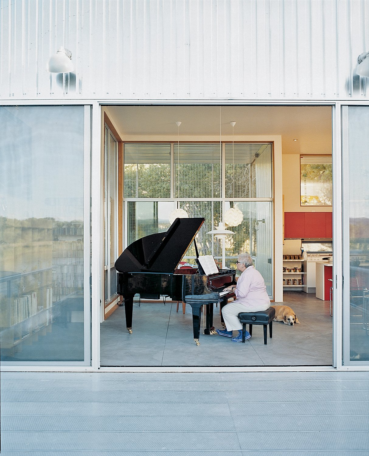 The architects built the house around Madeline's grand Schimmel piano. But that's not to say the pair wanted to live in a concert hall. Having a flexible living space and accommodating recital guests took priority.  Photo 5 of 10 in Abiquiu Debut