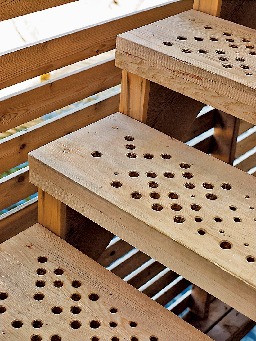 The stairs feature a geometric pattern of holes generated by a software script that allows rain to slip through to the lake below.  Photo 4 of 16 in Floating House, Lake Huron