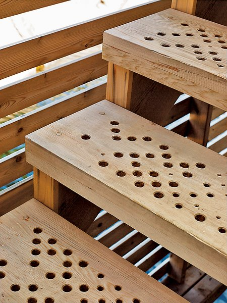The stairs feature a geometric pattern of holes generated by a software script that allows rain to slip through to the lake below.