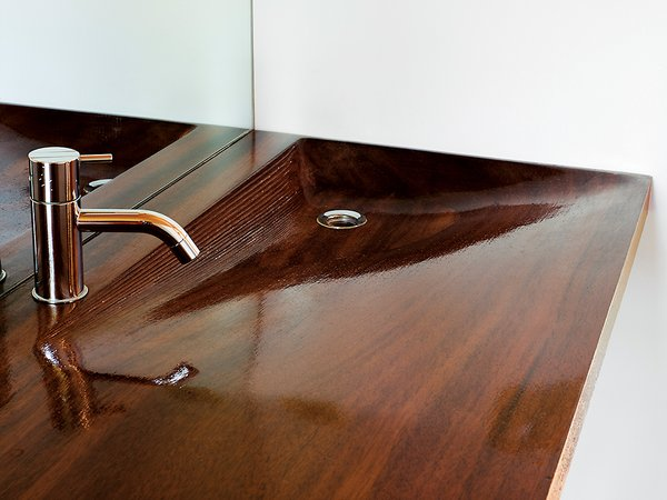A high-gloss iroko-wood sink in the sleeping cabin's bathroom, designed by architecture students at the University of Toronto.