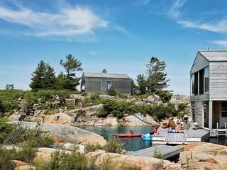 101 Best Modern Cabins - Photo 39 of 101 - The sleeping cabin perches on a rocky rise near the Floating House; Meredith imagines these two as a start of a string of buildings that will wrap around the island.