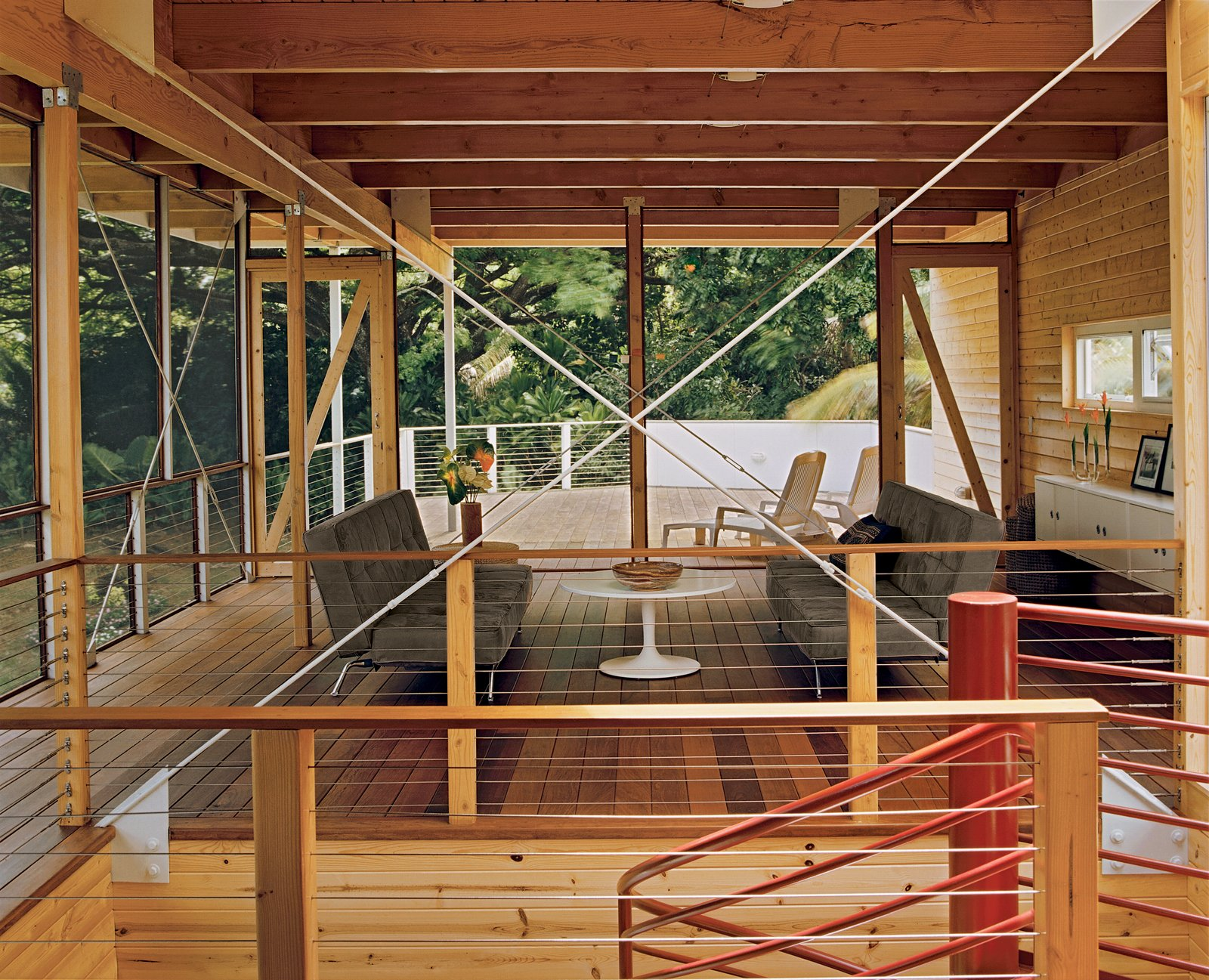 The living room, which opens directly to an ipe deck, is separated from the dining area by a central spiral staircase. Tagged: Living Room, Sofa, and Coffee Tables.  Photo 3 of 9 in Lava Flow 4, The Big Island