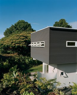 Corrugated siding usually used for roofing is used for the exterior.