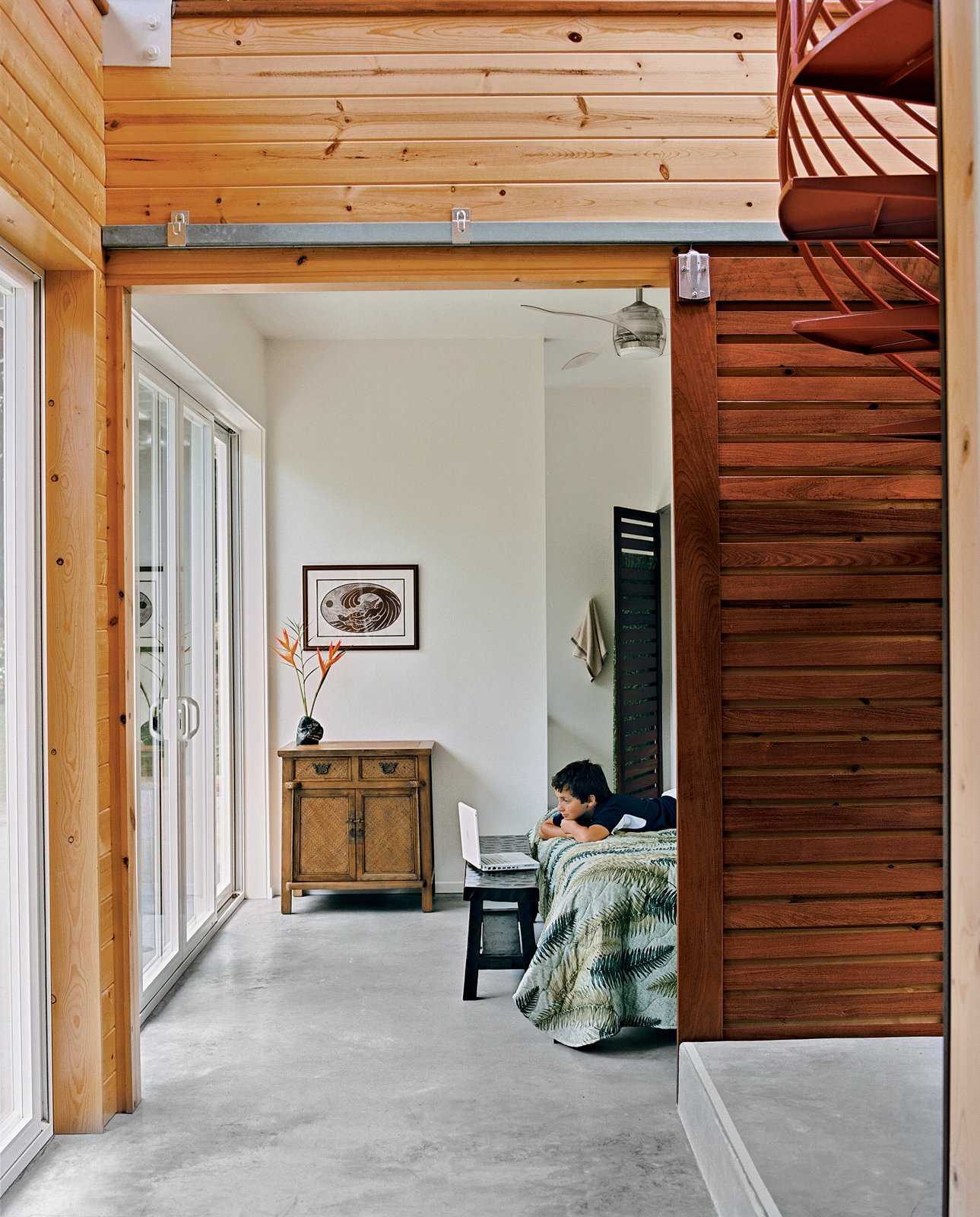 Kurokawa and Fishman's son Danny Fishman-Engel enjoys time away from the city by studying magic tricks in his bedroom. Sliding slatted doors separate the asymmetrical downstairs spaces. Tagged: Kids Room.  Photo 9 of 9 in Lava Flow 4, The Big Island