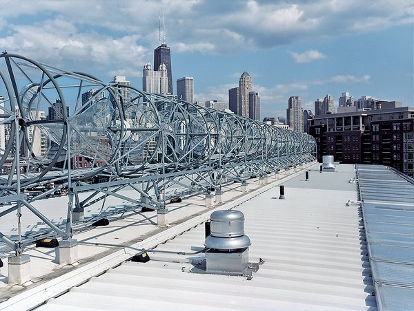 A horizon-line of rooftop wind turbines turns the skies of the Windy City into an omnipresent source of electrical power. Installed by the Chicago-based firm Aerotecture International, the turbines give the building both a steady supply of power and a distinct appearance, visible from several blocks away.